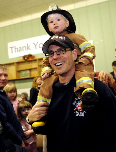 "N0118ALTO22.JPG_COBOU101.jpg Xander Servian, 2, wants to be a firefighter like dad. Caleb Servian of the Sunshine Fire District helped control the Olde Stage fire. Residents and volunteers held a ""Thank You"" dinner for all the  firefighting agencies, rescue agencies, police and volunteers that battled the Old Stage fire.  The  Altona Grange  building was packed on Saturday night. Cliff Grassmick / January 17, 2009"